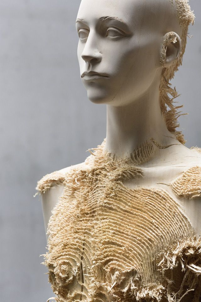 Distressed wood figures by Aron Demetz